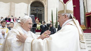 Pope Francis embraces Pope Emeritus  Benedict XVI during Mass before the canonisation ceremony of Popes John XXIII and John Paul II at St Peter's Square at the Vatican
